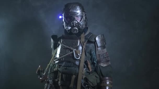 Man in consplay post apocalypse costume is posing for operator