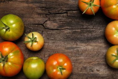 Tomatoes on old wooden background
