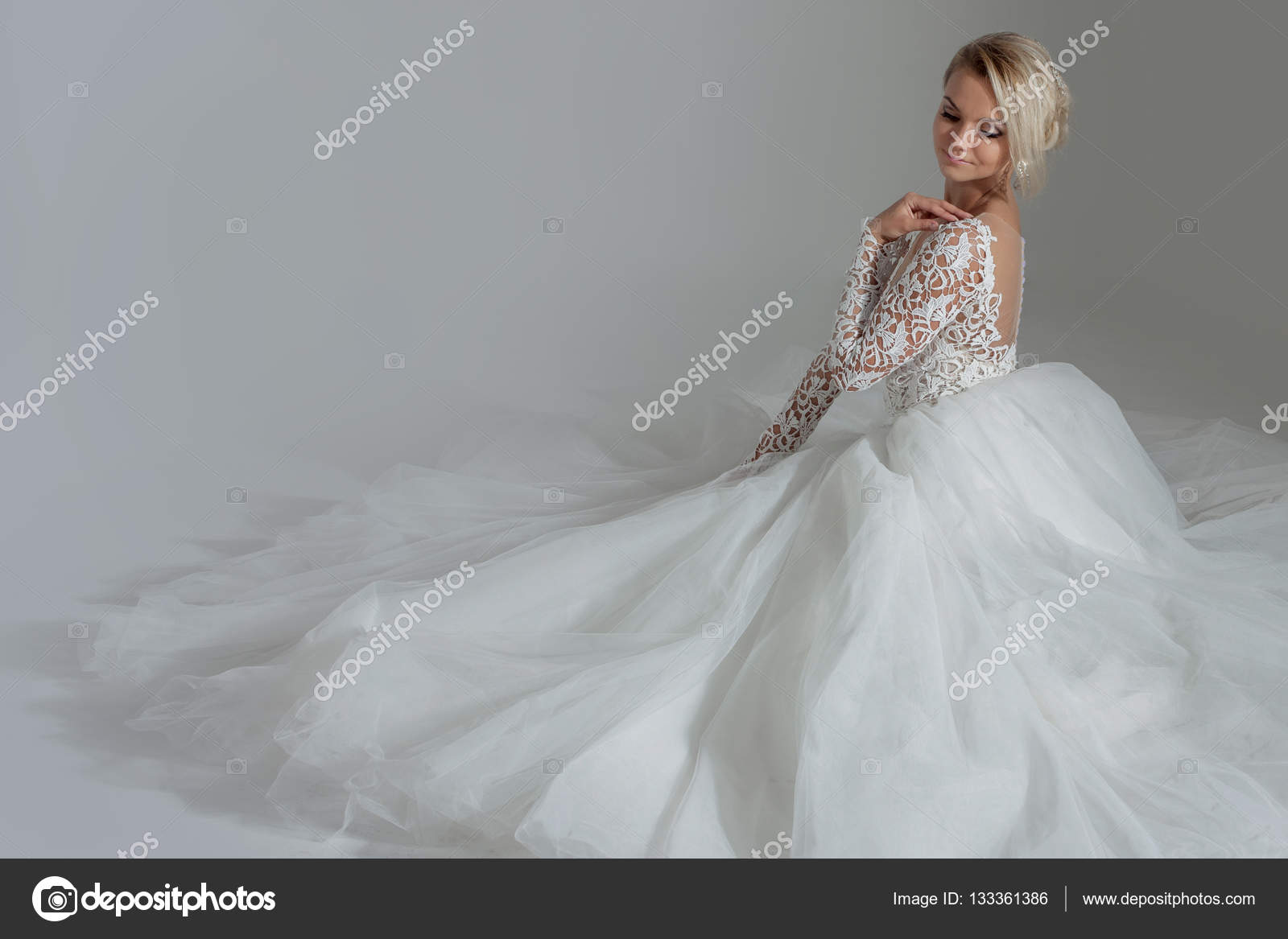 Beautiful Bride In Luxurious Wedding Dress Sitting Circle Long Skirts White Background Top View– Stock Image: Haute Couture Wedding Dress Sitting At Reisefeber.org
