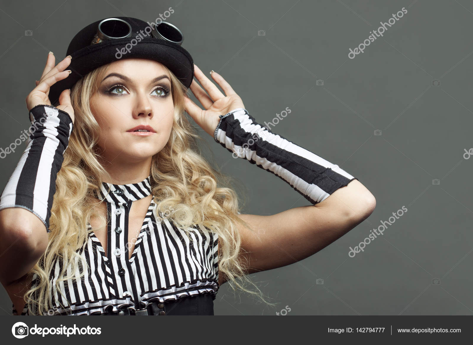 a01efd8952b Portrait of a steampunk woman in hat-bowler hat with goggles ...