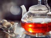 Fotografie Tea in a teapot, glass teapot, Cup, close-up
