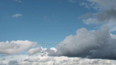Blue sky. Beautiful Cumulus clouds flying across the sky, twilight