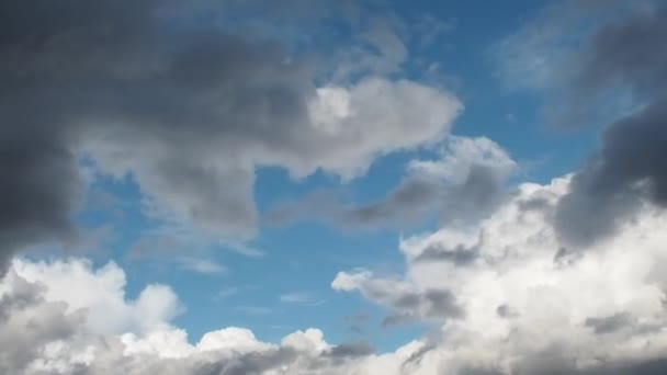 Dark clouds cover the blue sky, beautiful clouds flying across the sky