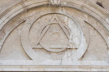 Eye in the pyramid, the bas-relief on the wall of the Church