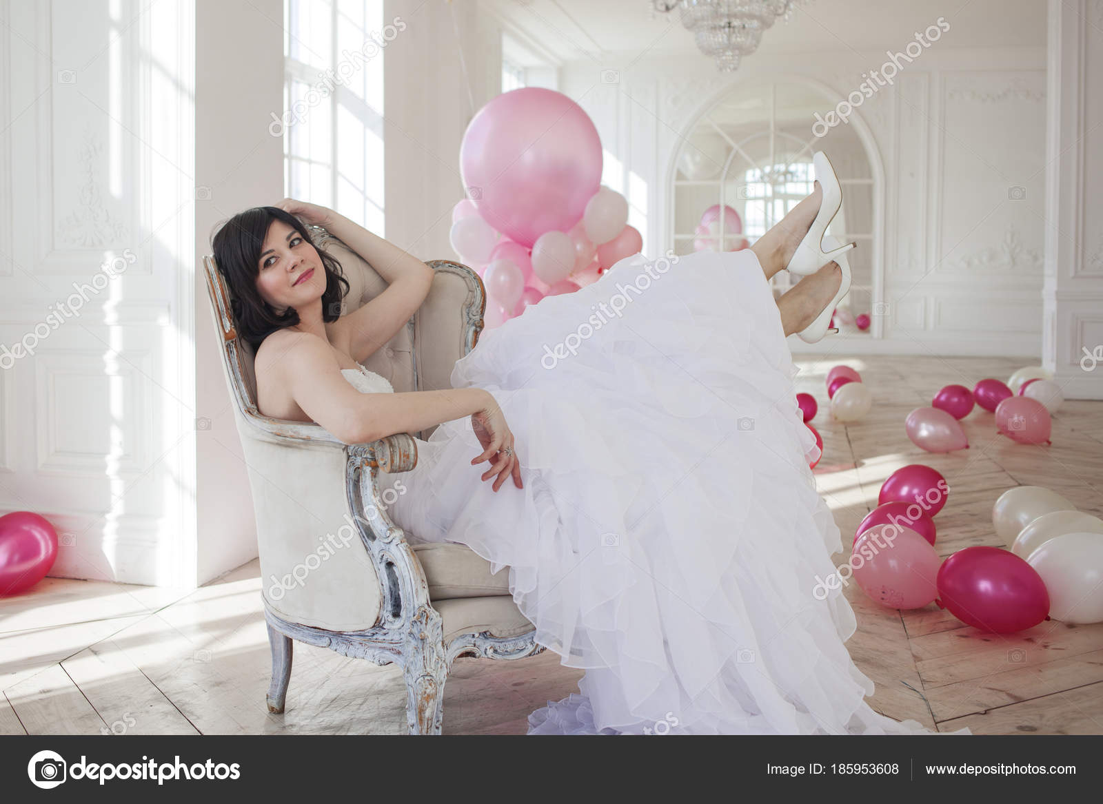 Young Woman In Wedding Dress In Luxury Interior With A Mass Of Pink