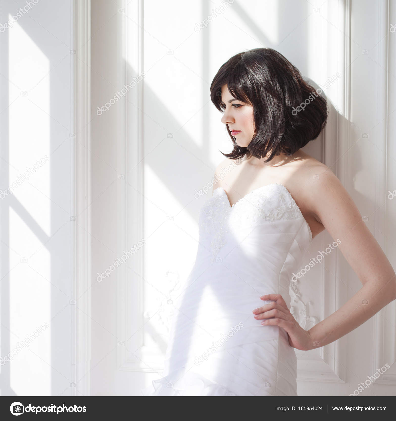 Portrait Of Young Attractive Brunette With Short Hair In A Wedding
