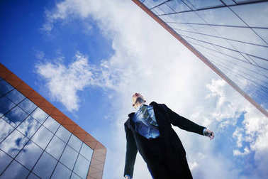 Male businessman looking at the sky. The concept of an ambitious person, goal-setting