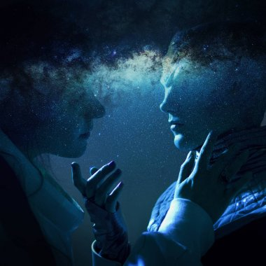 Woman and an alien look at each other. Contact with other civilizations. Space and galaxy