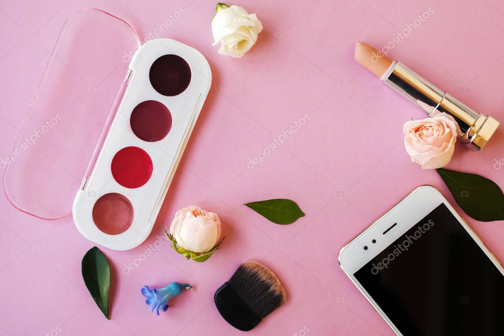 Set cosmetics and Smartphone , women's style, pink background