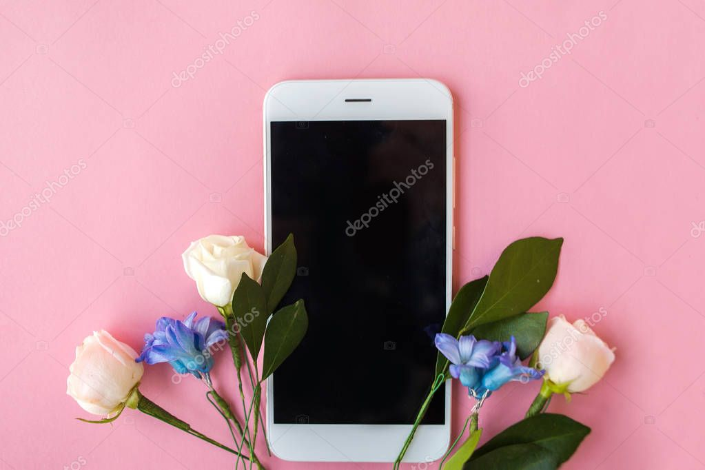 Smartphone mockup. flowers on pink background, free space for your text
