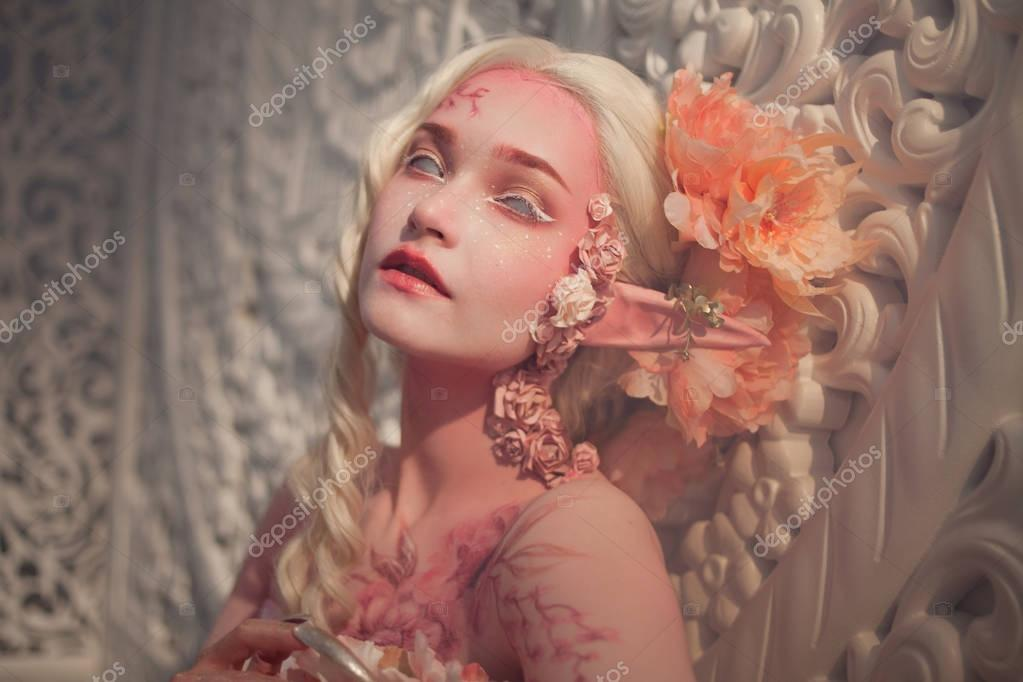 Young beautiful girl elf. Creative make-up and bodyart