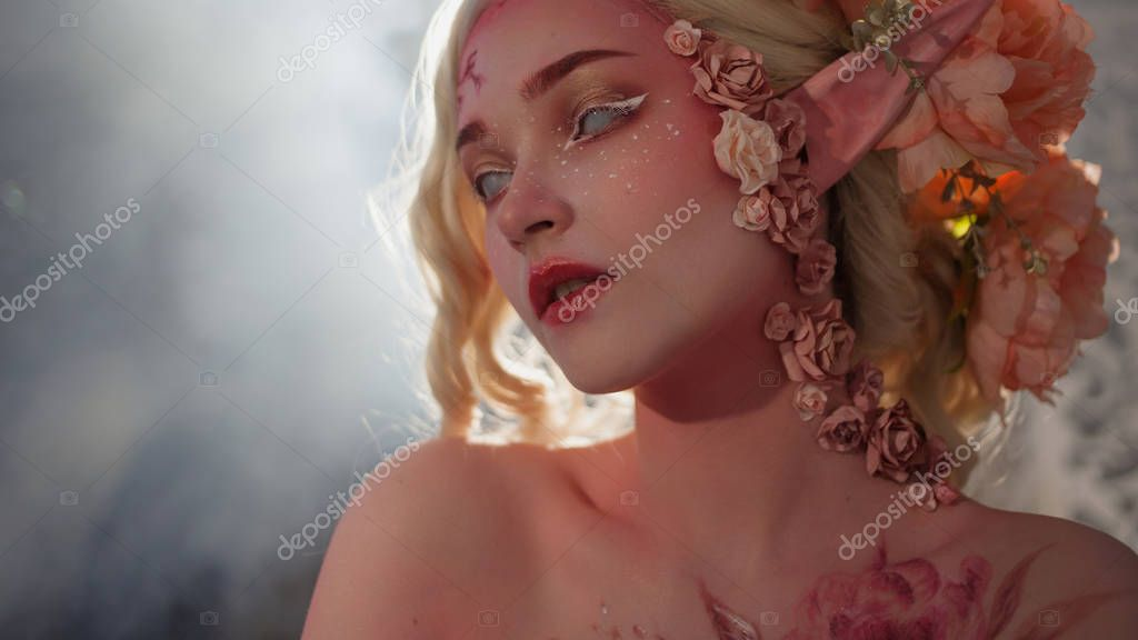 Mysterious elf girl. Creative pink makeup. Elvish ears.