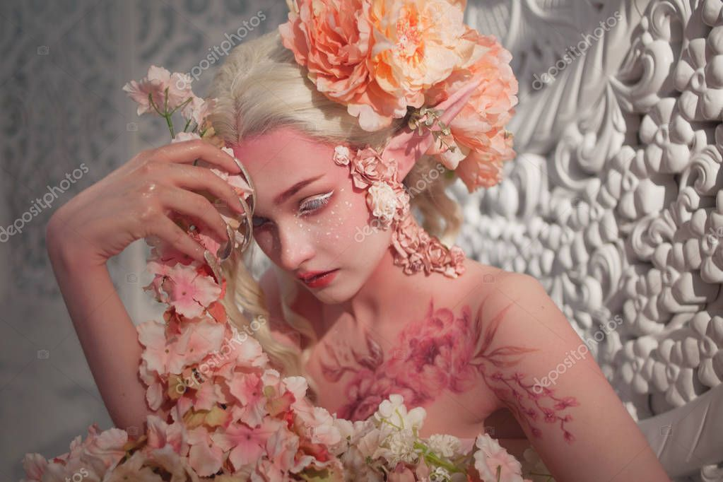 lovely she-elf among flowers. Creative make-up and bodyart