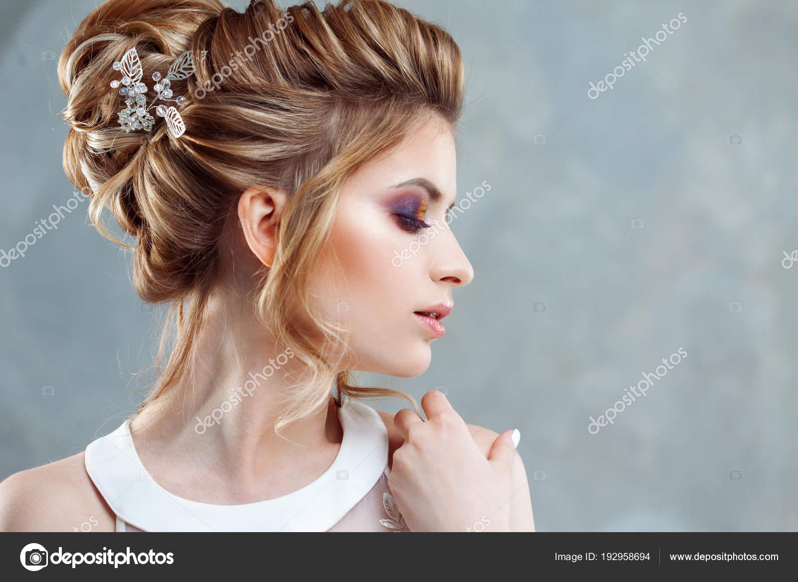 Young Beautiful Bride With An Elegant High Hairdo Wedding