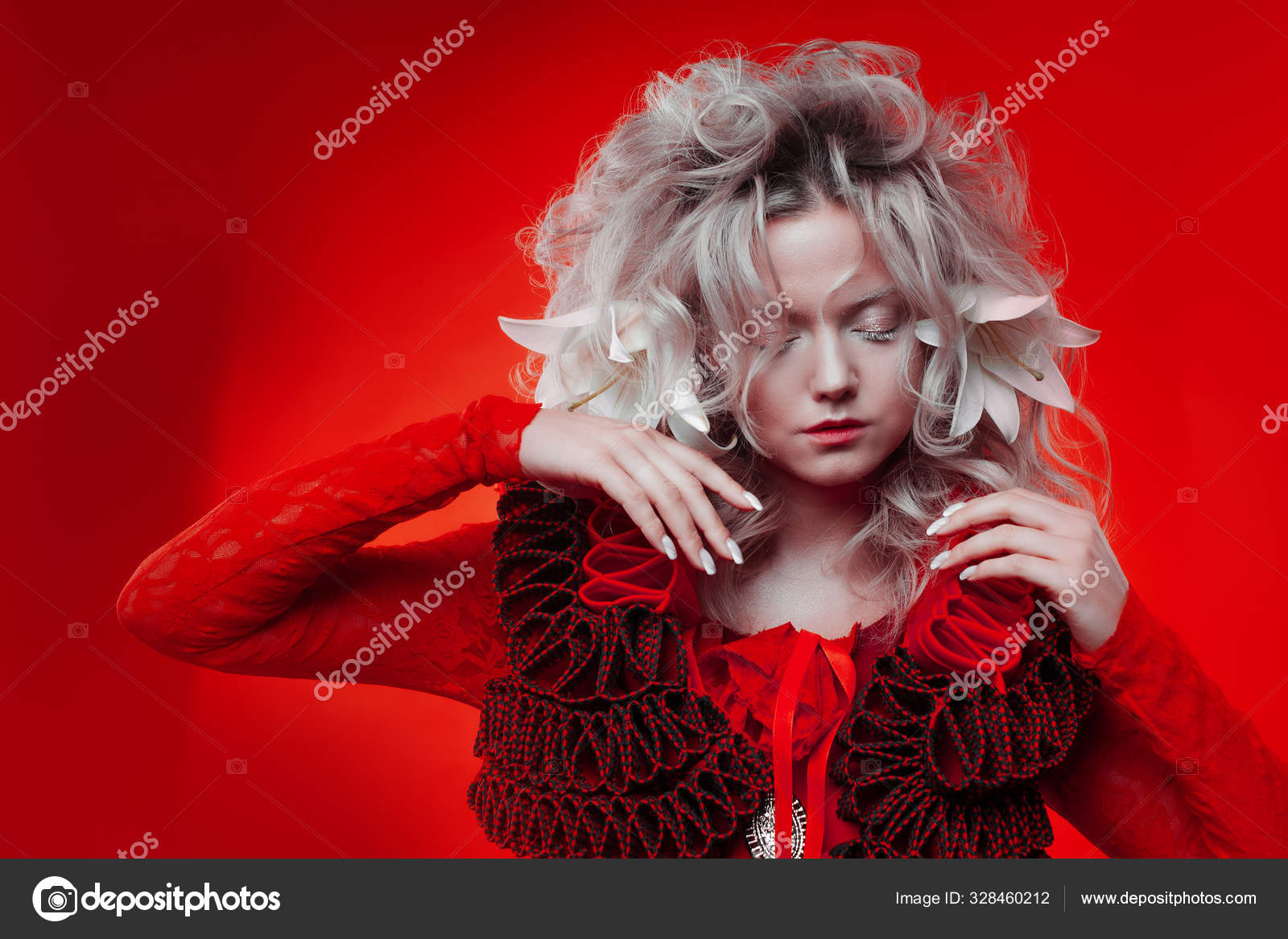 Shades Of Red Strange Attractive Woman In A Red Outfit On A Red Background With Lily Flowers In Her Hair Stock Photo C Kriscole 328460212