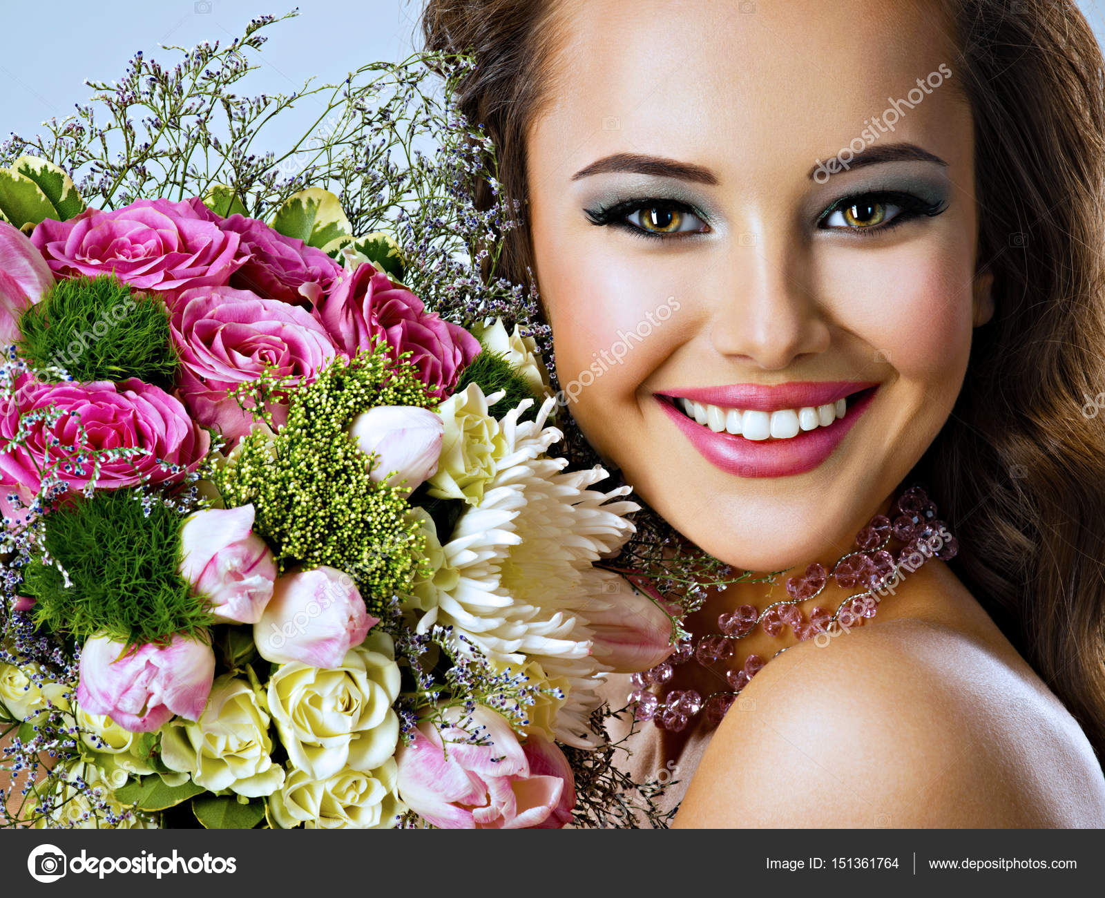 Happy beautiful girl with flowers in hands stock photo closeup portrait of beautiful happy girl with flowers in hands young attractive woman holds the bouquet of spring flowers photo by valuavitaly izmirmasajfo