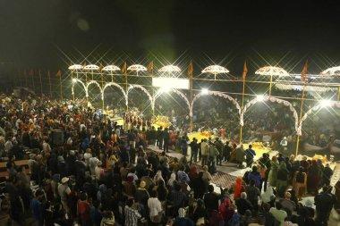 Chhatri umbrellas cover the aarti evening prayer service