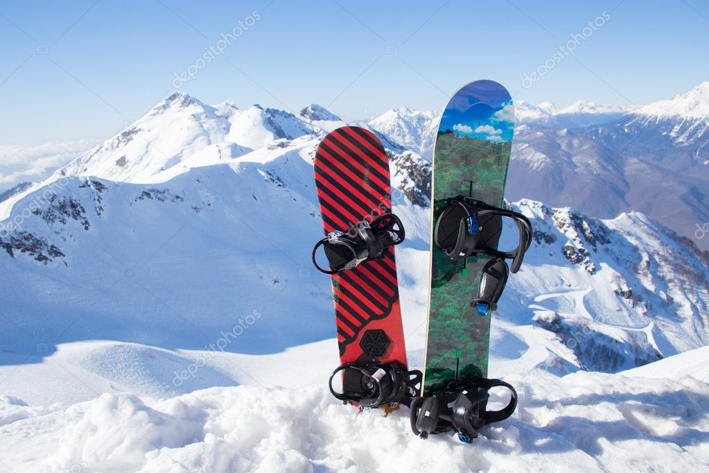 Snowboards in snow in mountains