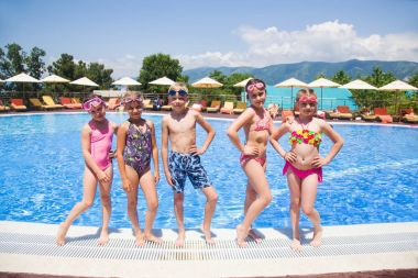 Children play in  pool at the resort