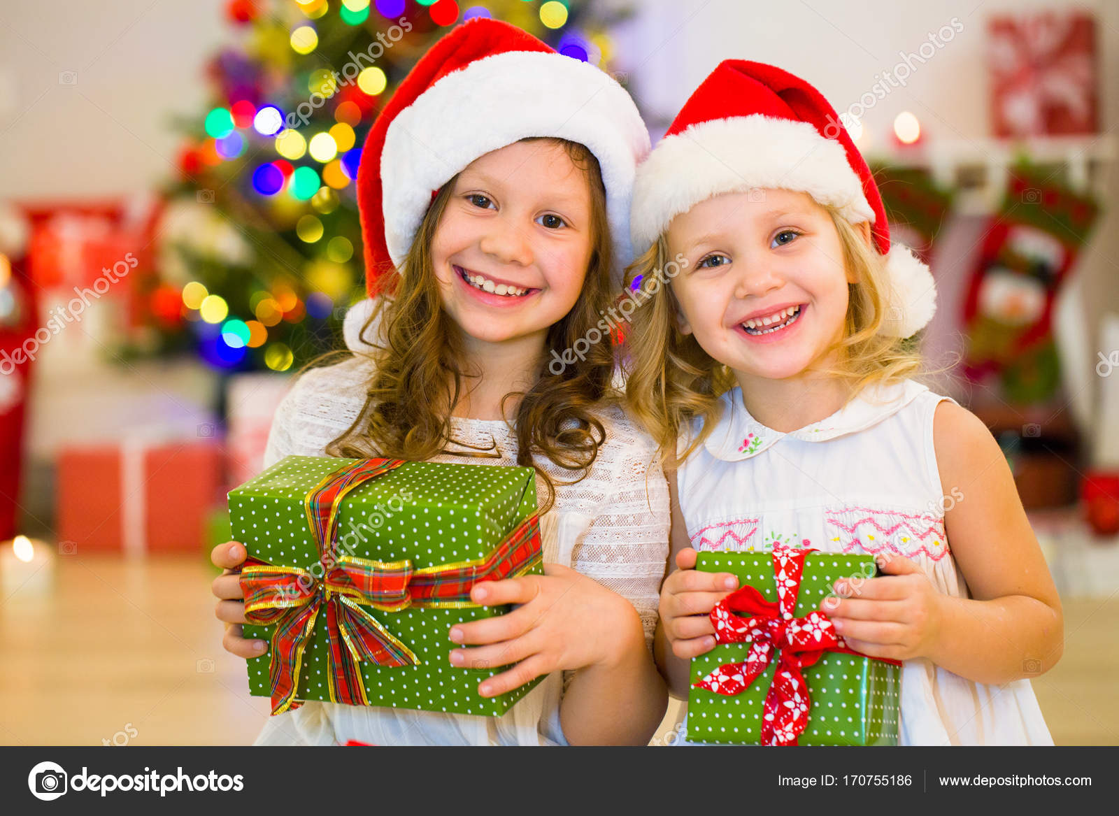 90e846be9b944 little girls in christmas day — Stock Photo © yanlev  170755186