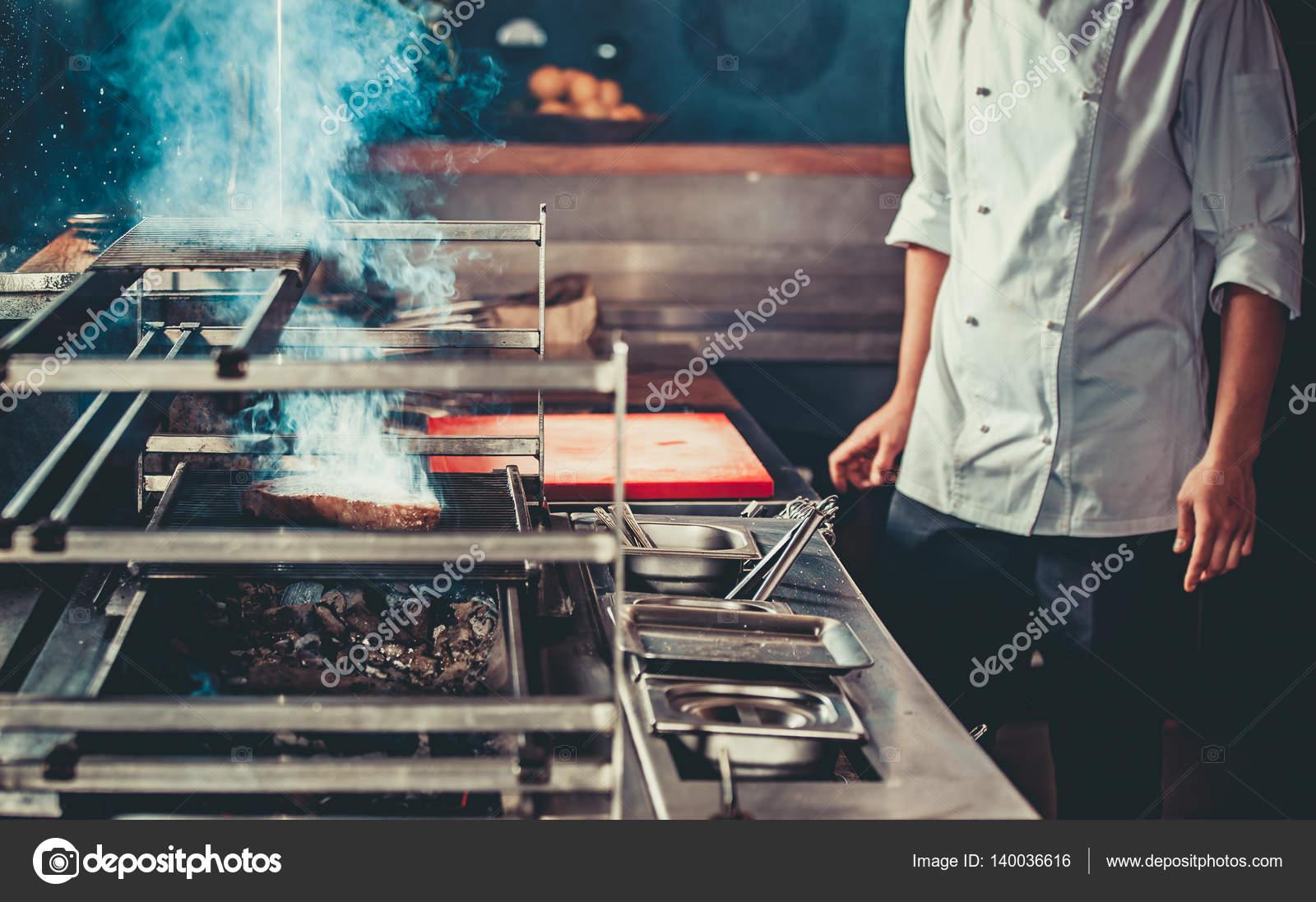 busy restaurant kitchen. Busy Chef At Work In The Restaurant Kitchen \u2014 Stock Photo ,