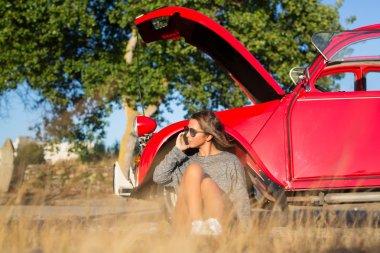 Woman on a roadtrip having a problem car