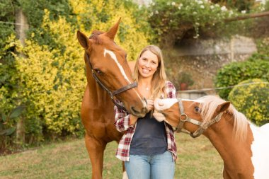 Young beautiful woman with a horses