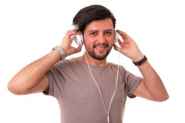 Handsome man listening to music on headphones