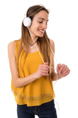 Beautiful young woman listen music with headphones, isolated
