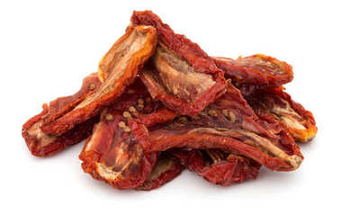 Dried tomatoes on white