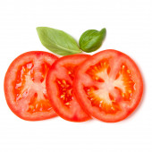 Slices of tomato and basil leaves isolated on white background.