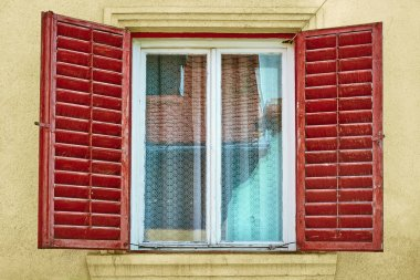 Window with Opened Shutters