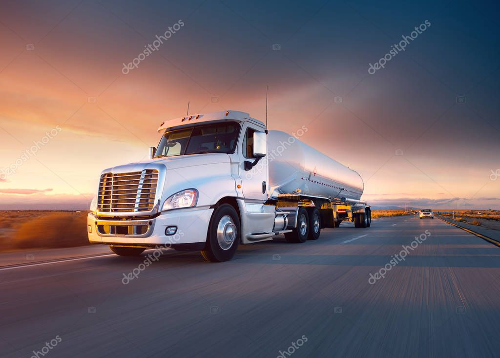 Truck cistern and highway at sunset - transportation background.