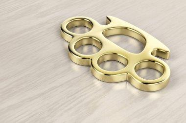 Golden brass knuckles