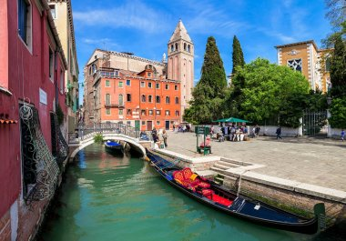Canal and small town square in Venice, Italy.
