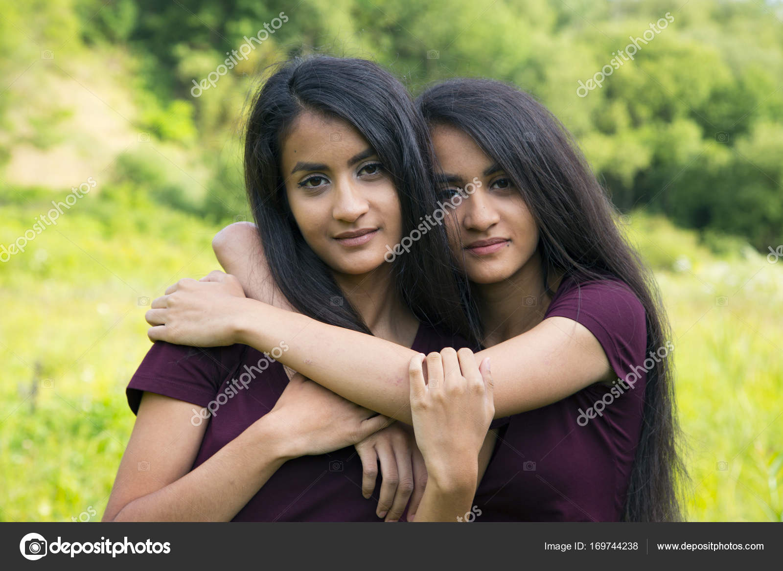 Female Twins Embrace Each Other Stock Photo Colour 169744238