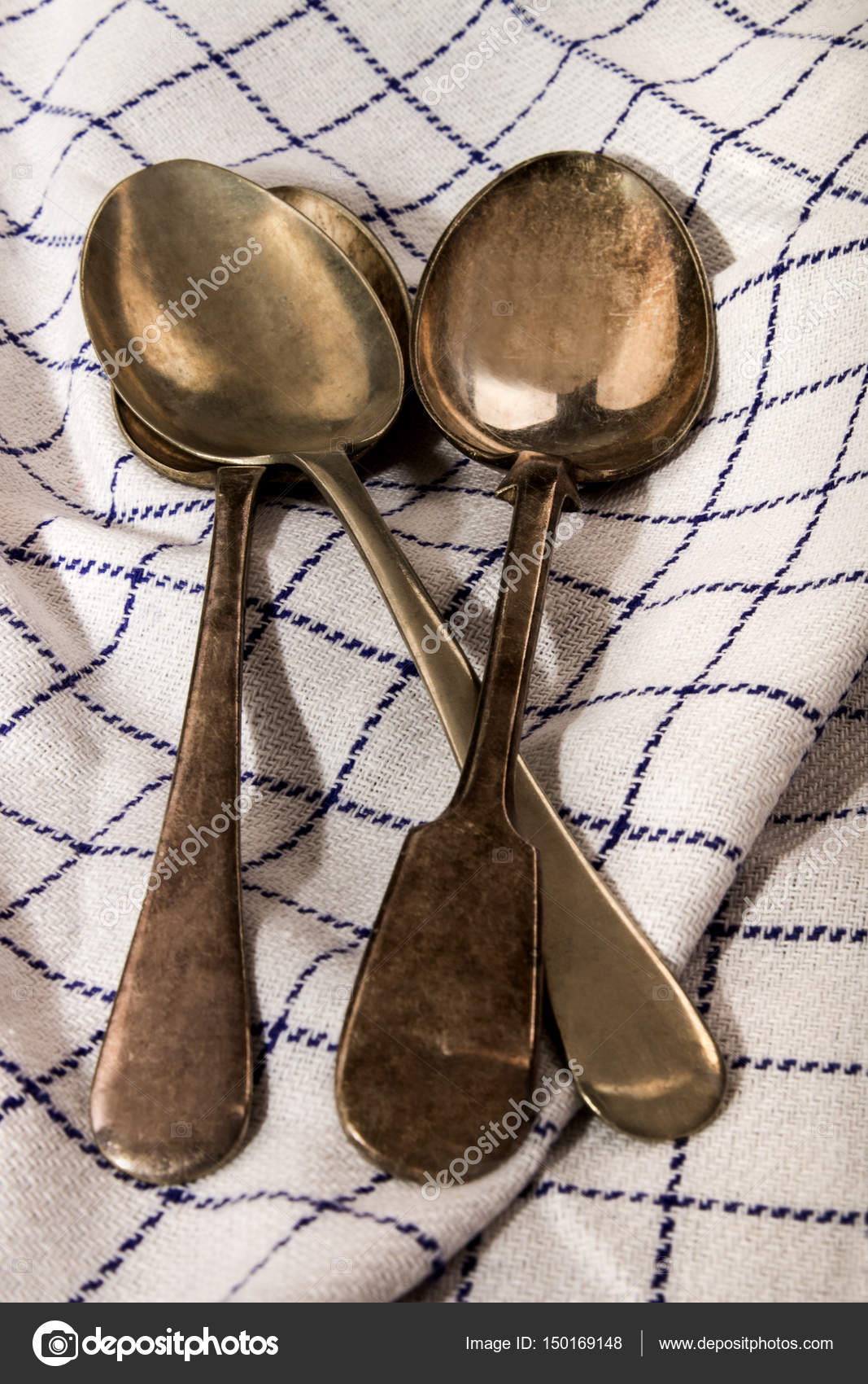 Three Old Silver Spoons On A Blue And White Kitchen Towel U2014 Stock Photo