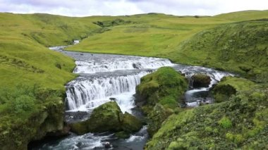 River flowing into the waterfall Skogafoss in Iceland