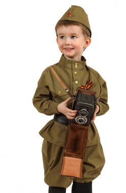 The little boy with retro photo camera over white