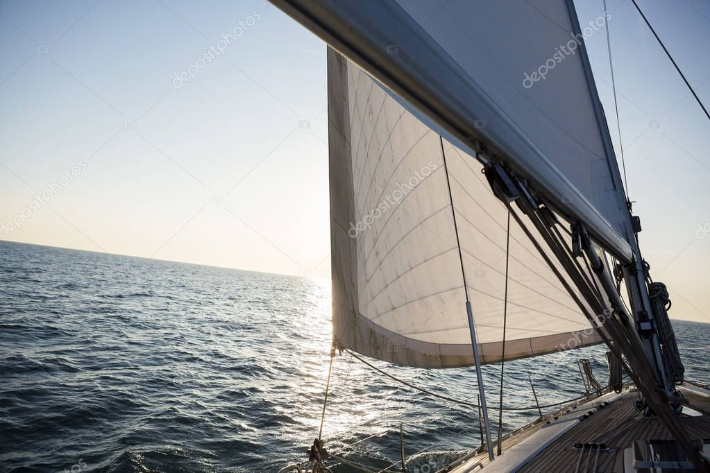 Yacht Sailing On Sea During Sunset