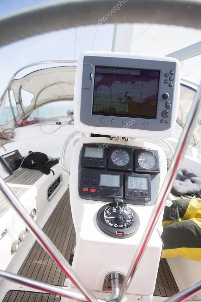 GPS Navigator At Helm Of Yacht