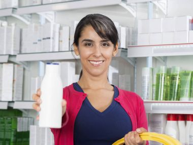 Woman Recommending Shampoo In Drugstore