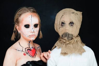 Halloween Dead Doll and Jackstraw. Young Boy and Girl with Hallo
