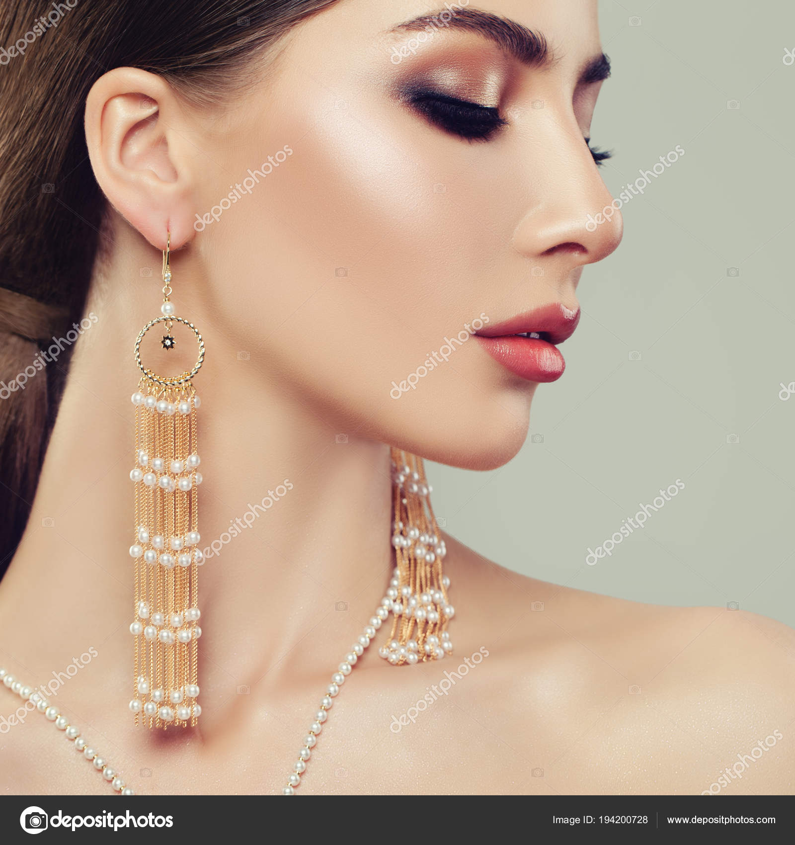 Attractive Woman With Makeup And Gold