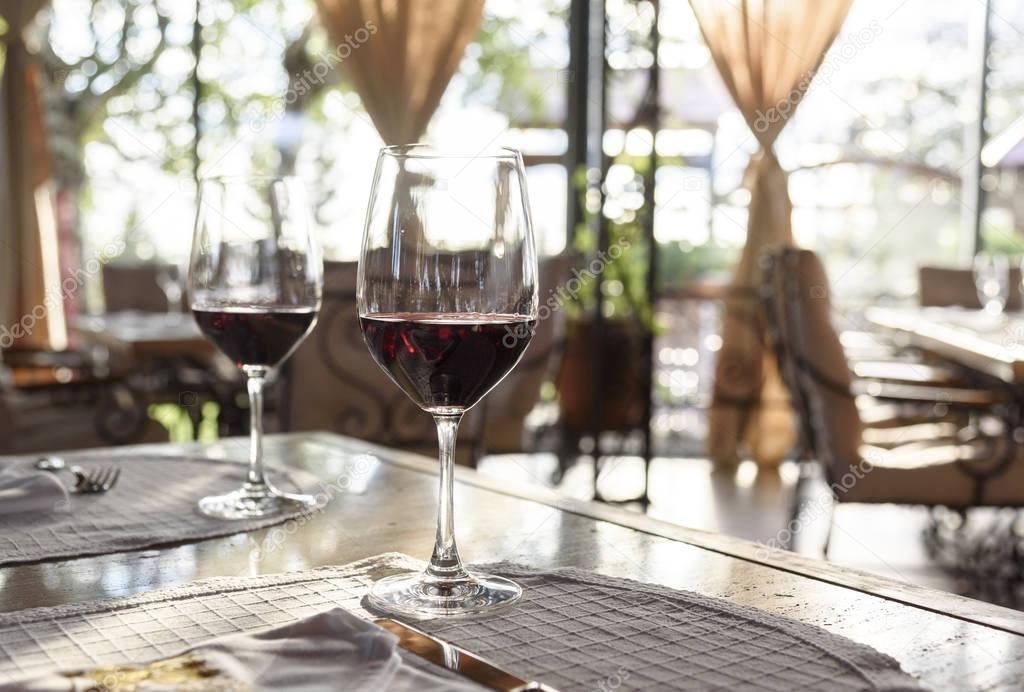 Restaurant Table With Red Wine Glasses Stock Photo Hitdelight - Fancy restaurant table