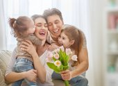daughters with dad congratulate mom
