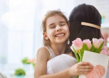 daughter congratulates mom