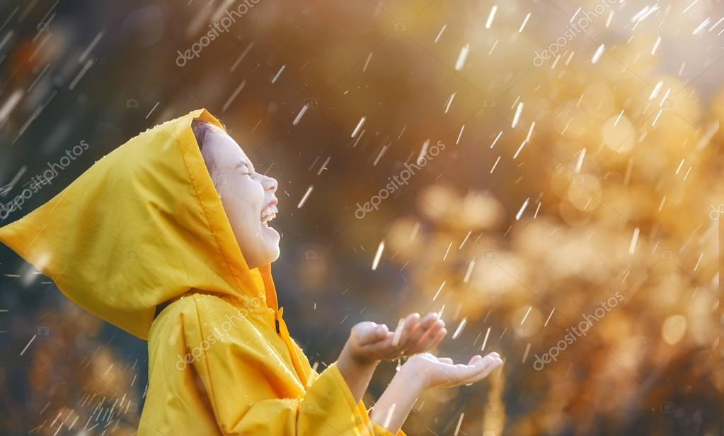 child under autumn rain