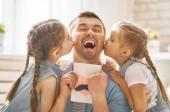 daughters congratulating dad