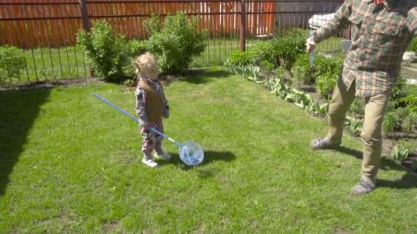 Girl catches soap bubbles